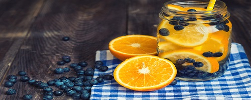 Detox water with orange and blueberries in jar