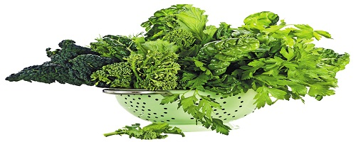 Different types of green vegetables in a stainless colander
