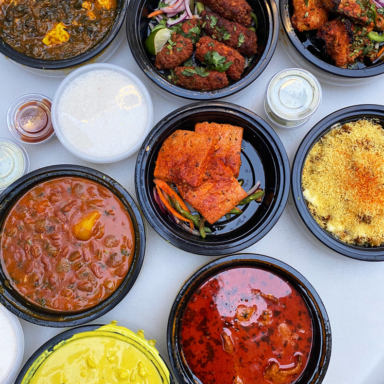 Spread of takeout dishes from Angel Indian restaurant in Queens