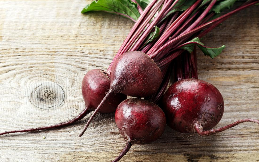 raw-beetroot-on-a-wooden-surface